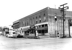 Oswego photographer Homer Durand snapped this photo of the Union Block in the spring of 1958, four years after the decorative cornices had been removed. A fair amount of the block's original Italianate accents remained, however. (Little White School Museum collection)