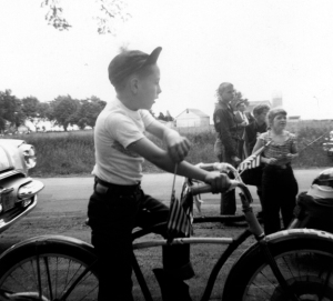 The author as a young biker with his cycle decorated for the annual Memorial Day Parade, but nonetheless ready to rumble.